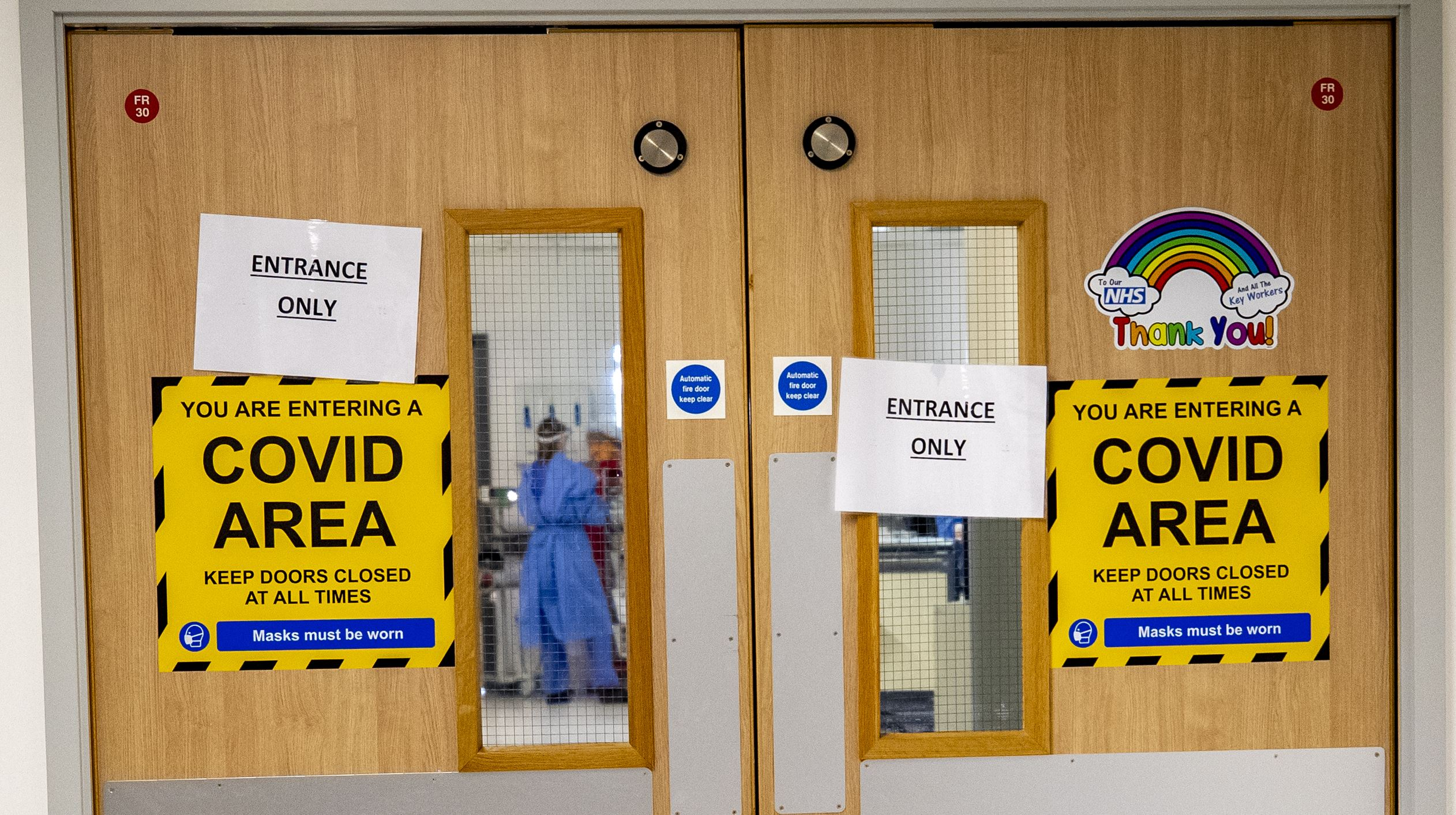 Hospitals compared to 'warzones' as PM orders lockdown