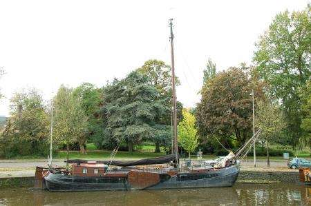 One of the well preserved traditional boats tied up along the broad defensive canal at Leeuwarden