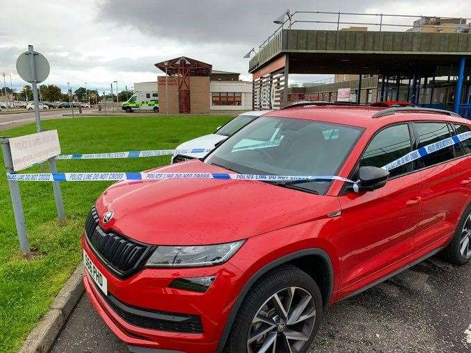 The Skoda was roped off with police tape.
