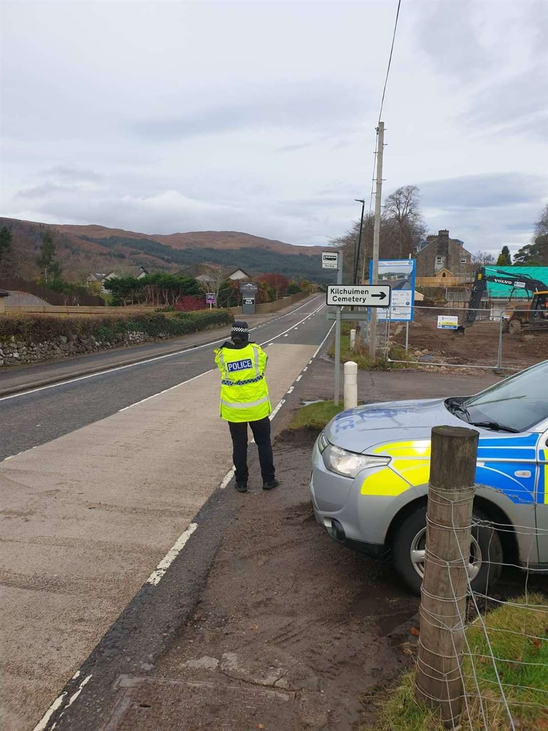 A police officer monitors vehicle speeds in Fort Augustus.