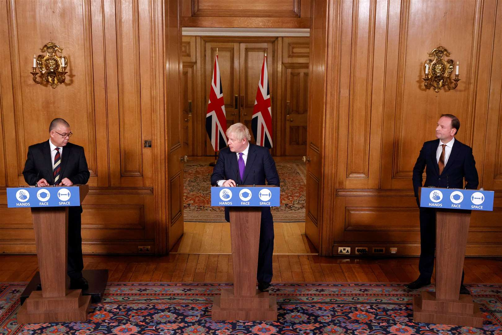 Professor Jonathan Van-Tam Prime Minister Boris Johnson and Sir Simon Stevens during a media briefing in Downing Street