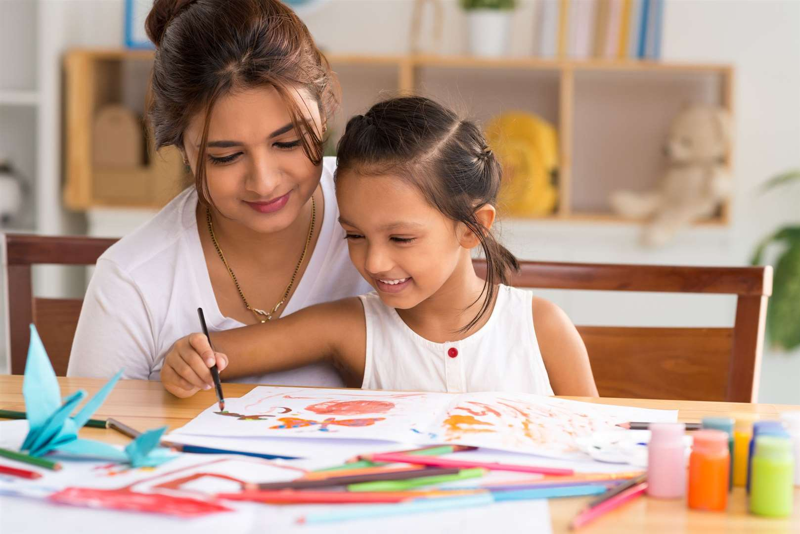 Painting with your child can help them to express their emotions and improve their wellbeing. Picture: iStock/PA