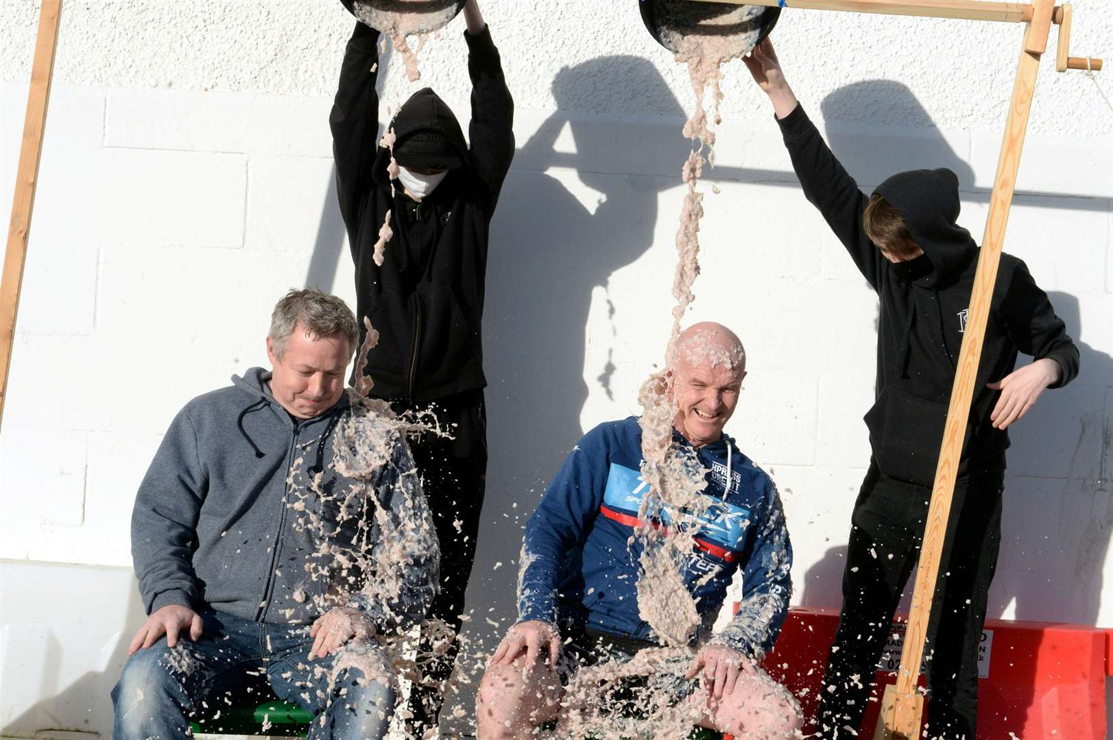Computing teacher Darren Brown and PE teacher Bruce Morrison are gunged by Wiktor Chwalek and Scott Sutherland.