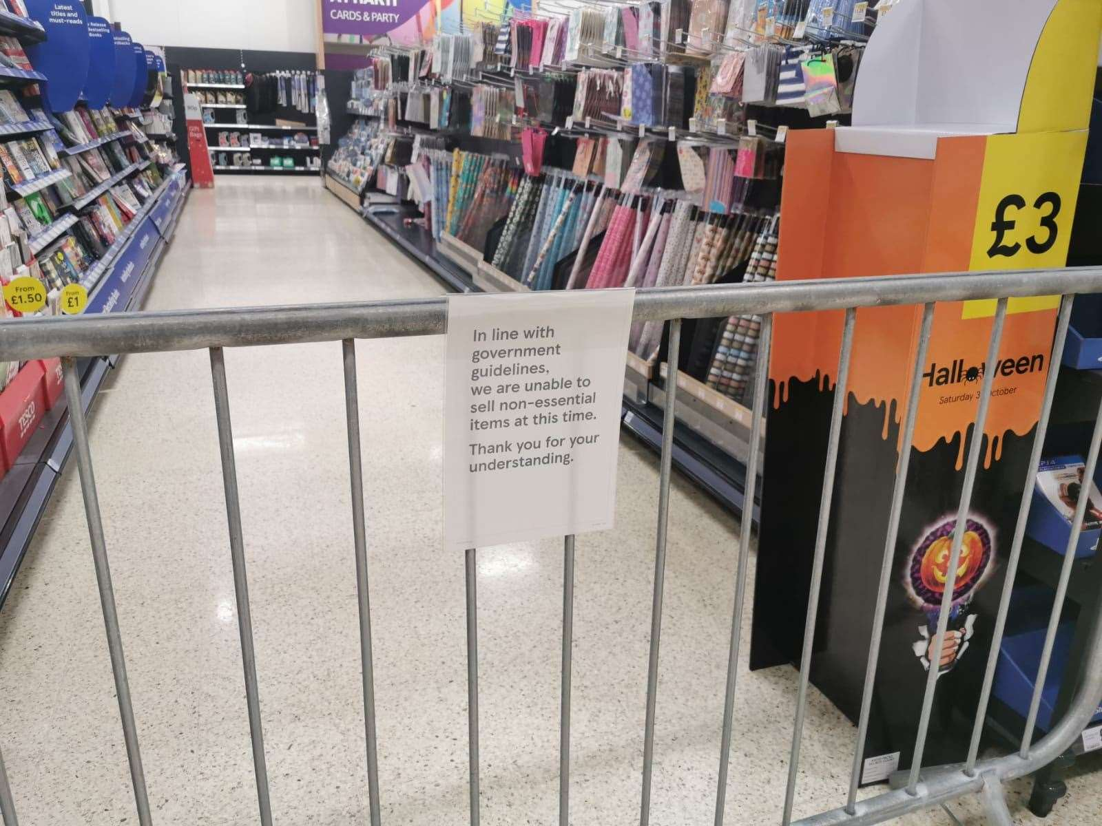 A notice informing customers of the sales of non-essential products at a Tesco Extra store in Pengam Green, Wales (Adam Hale/PA)