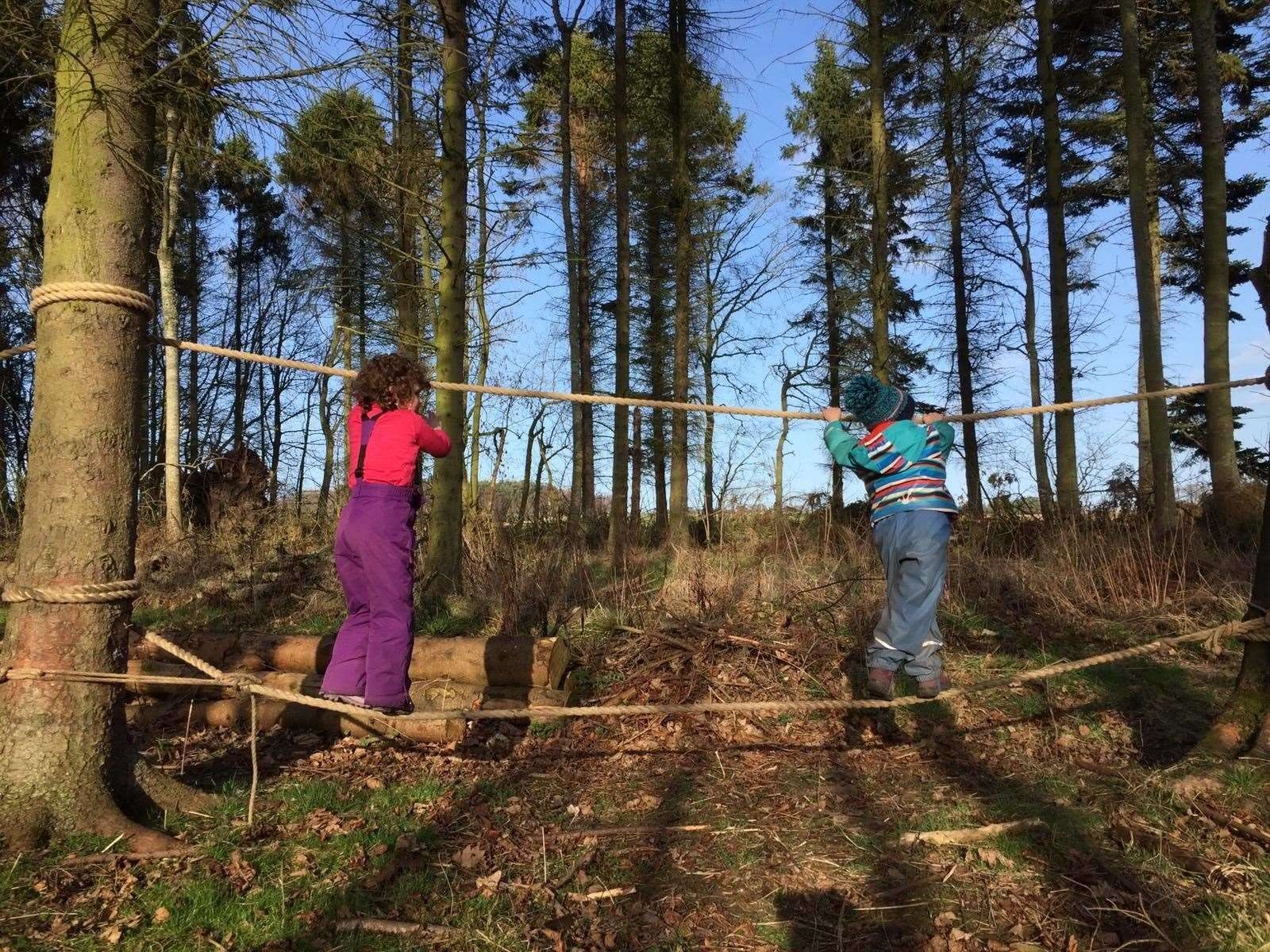 Youngsters enjoy outdoor play at Earthtime Forest School in Duffus, Moray.