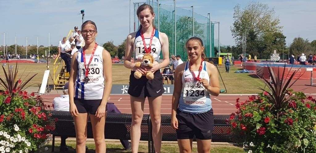 Alness athlete Abbie McNally (centre) of Inverness Harriers won gold and bronze at the England Athletics championships in Bedford.