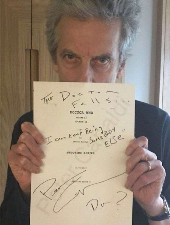 Peter Capaldi with his signed script for the episode The Doctor Falls (CHAS/PA)