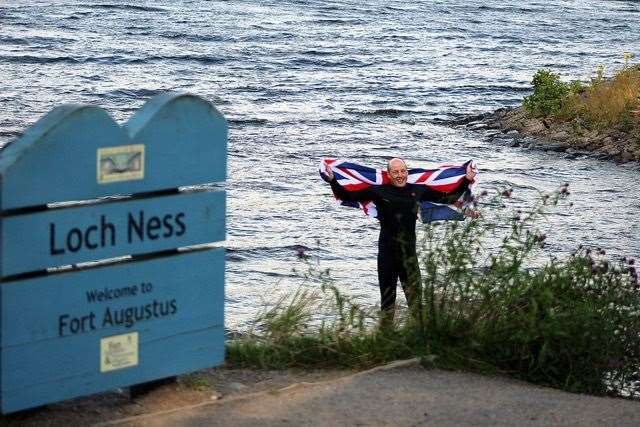 Record breaker James Fletcher as he reaches the end of his challenge on Loch Ness.