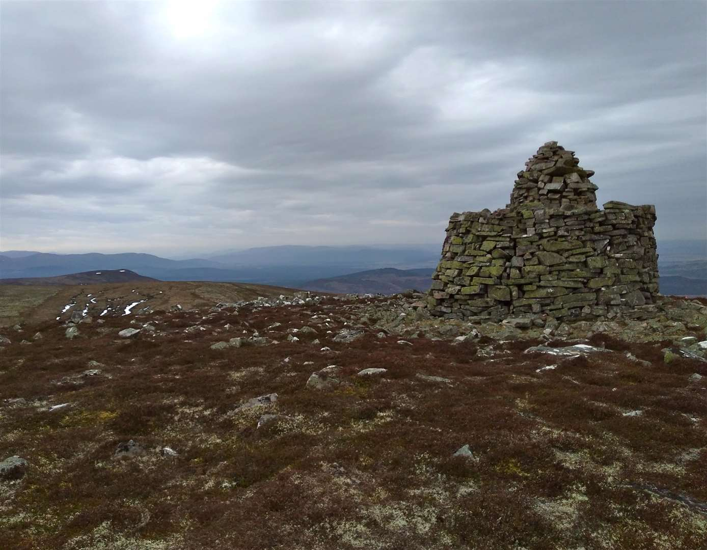 Jubilee Cairn and the distant Cairngorms.