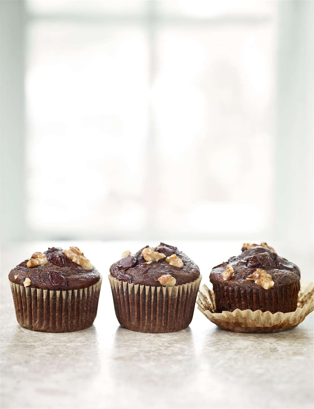 Chocolate banana muffins from Deliciously Ella: Quick & Easy by Ella Mills. Picture: Nassima Rothacker/PA