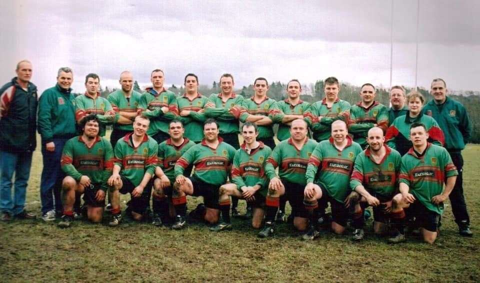 Dave Carson in his first spell as Highland Rugby Club head coach, on the left of a team photo.