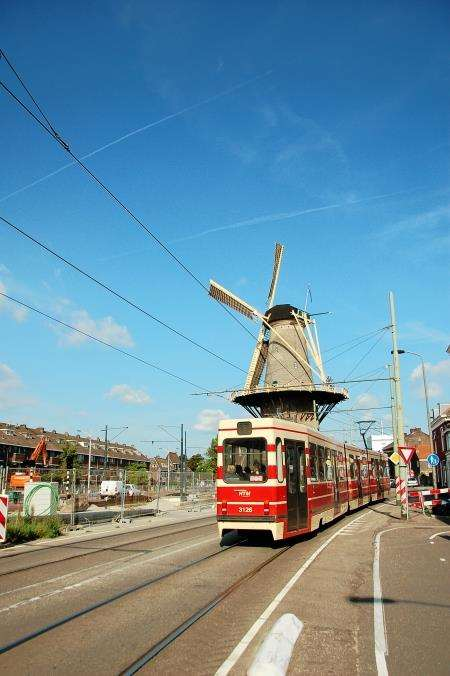 Tram no. 1 swings round the windmill returning from Delft to Den Haag