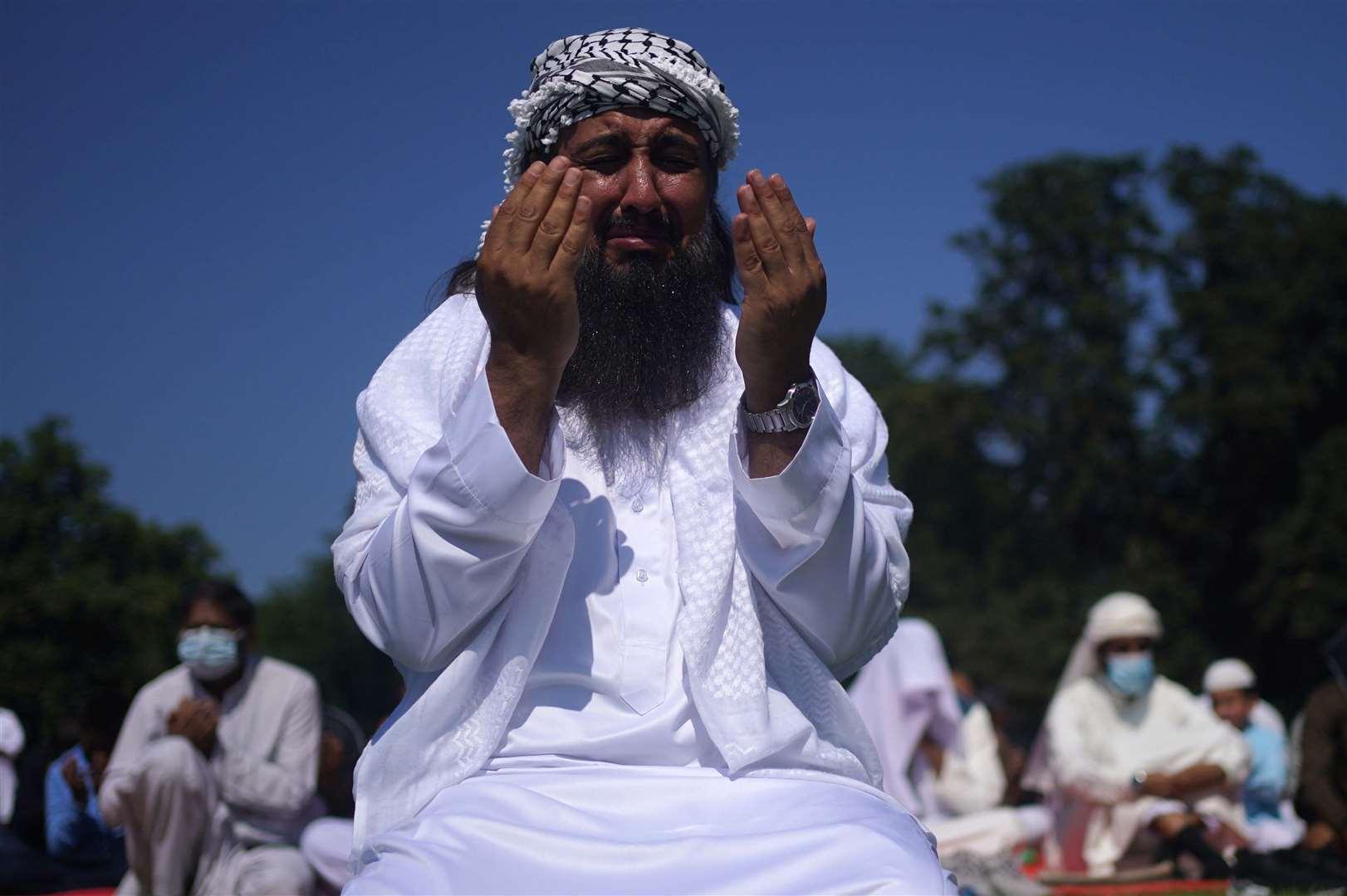People during morning prayers during Eid al-Adha (Victoria Jones / PA)