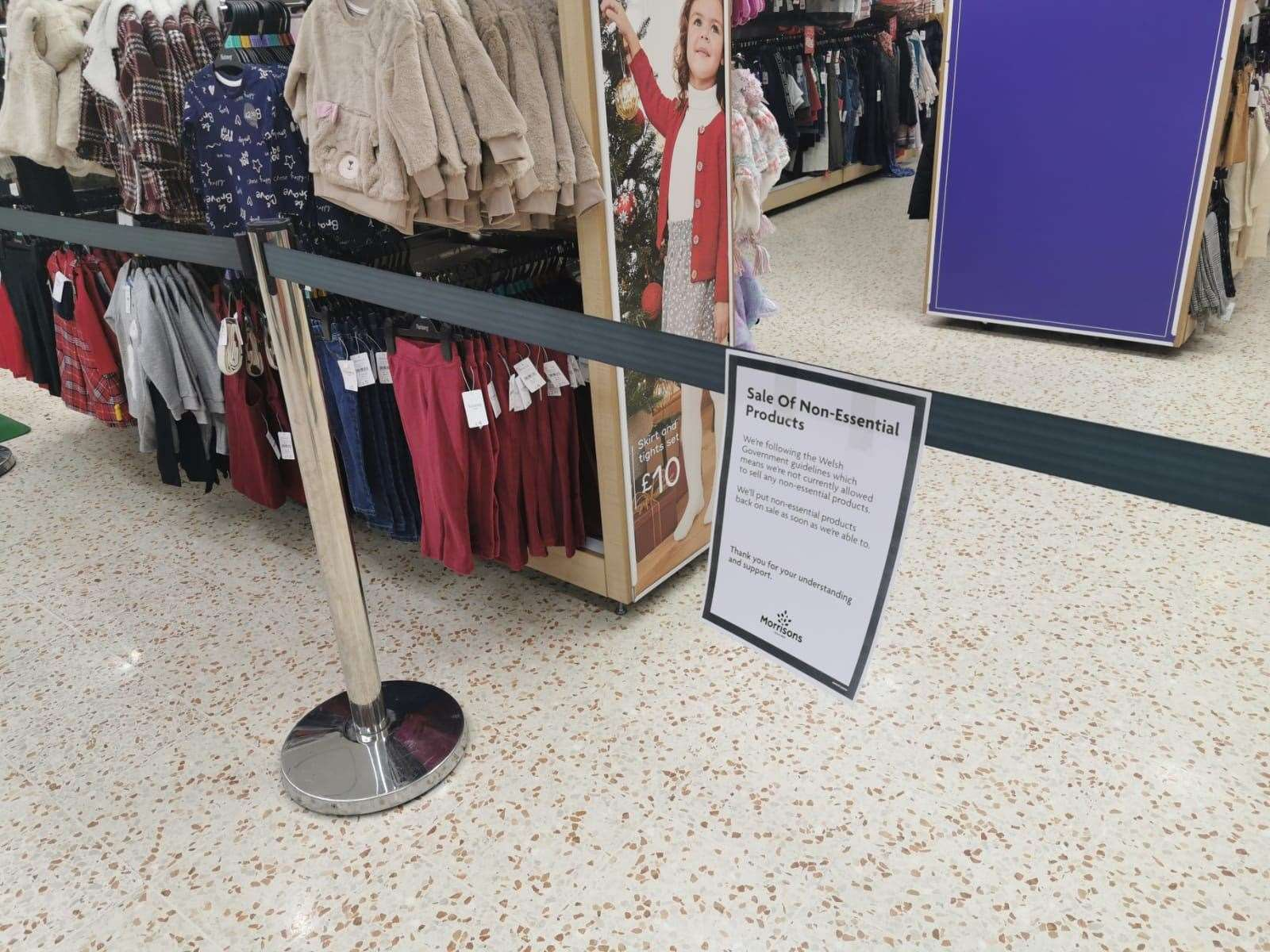 A notice informing customers of the sales of non-essential products in a Morrisons store in Cardiff Bay (Adam Hale/PA)