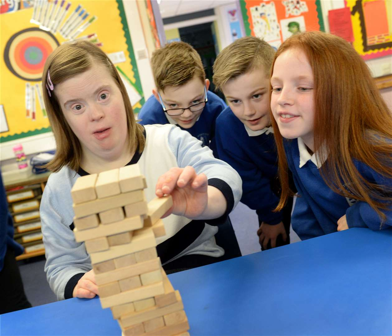 Alison Cameron plays Jenga with James Stewart, Conner Dyce and Eva Mathieson.